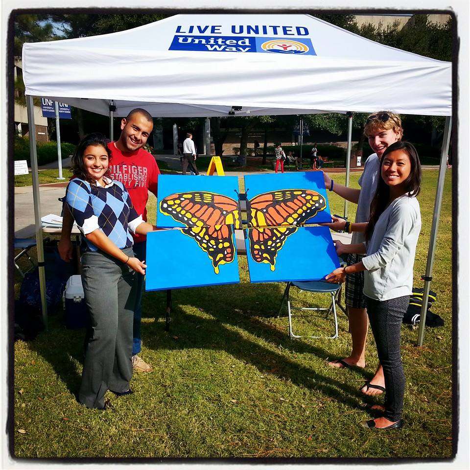 University of North Florida Student United Way volunteers team up to paint murals for the Sandalwood Family Resource Center.