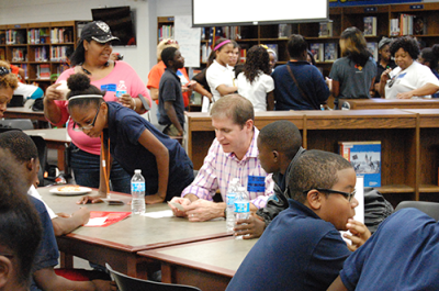 Availity staff and CEO Russ Thomas celebrate the success of Ribault Middle Achievers For Life Students with a pizza party in October 2014. This is one of the many ways Availity has shown their support of improving educational outcomes.