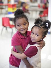 2 students hugging