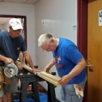 Two men working with wood for new shelves