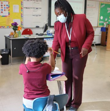 picture of Ms. Phyllis Clay, Grade 4 teacher, with student