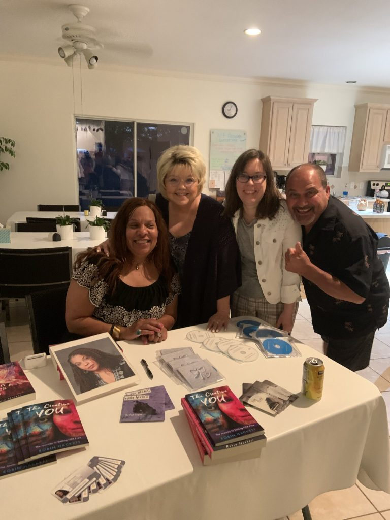 Singer/Songwriter Robin Hackett with attendees at her merchandise table, July 10, 2021