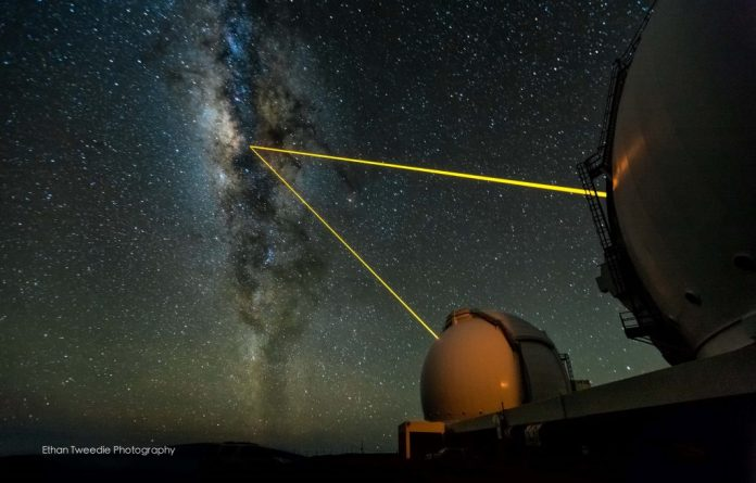 The twin Keck telescopes shooting their laser guide stars into the heart of the Milky Way on a beautifully clear night on the summit on Mauna Kea. Credit: keckobservatory.org/Ethan Tweedie