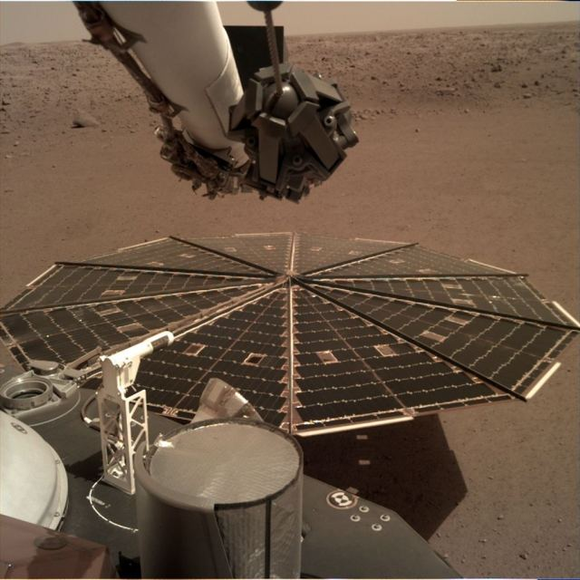 One of two Mars InSight's 7-foot (2.2 meters) wide solar panels was imaged by the lander's Instrument Deployment Camera, which is fixed to the elbow of its robotic arm. Accumulated dust on the panels has reduced the power available to the mission. Credits: NASA/JPL-Caltech