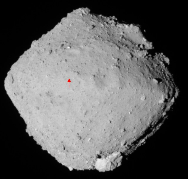 Asteroid Ryugu, as imaged by the Hayabusa2 spacecraft. Ryugu is a rubble pile asteroid, and as such has no molten core, and is not differentiated. They're common, and about half the asteroid's volume is empty space. The red dot marks Hayabusa 2's sampling location. Image Credit: JAXA/Hayabusa2