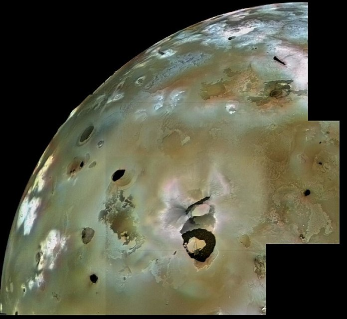 A Voyager 1 image mosaic of Loki and the surrounding surface of Io, including lava flows and volcanic pits. Numerous volcanic calderas and lava flows are visible here. Loki Patera, an active lava lake, is the large shield-shaped black feature. Image Credit: By NASA/JPL/USGS - http://photojournal.jpl.nasa.gov/catalog/PIA00320, Public Domain, https://commons.wikimedia.org/w/index.php?curid=4898984