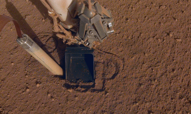 InSight's Heat Probe (HP3) popped out of its hole shortly after deployment. Image Credit: NASA/JPL-Caltech