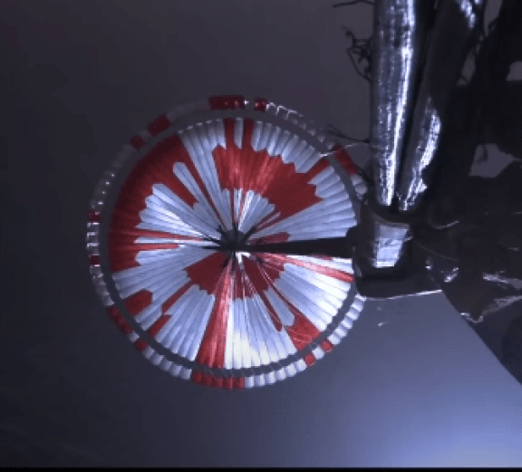 """NASA is having some fun. The odd red pattern on the underside of Perseverance's parachute contain a 10-bit binary pattern that reads """"Dare Mighty Things."""" Image Credit: NASA/JPL/Caltech"""