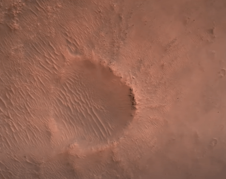 This is one of the small craters inside Jezero Crater that drifted into and out of view of the landing camera. Image Credit: NASA/JPL/Caltech.