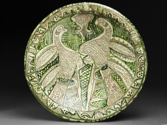 Dish with paired birds, Iran, 12th century, earthenware with decoration incised through a white slip and painting in green, EA1956.120