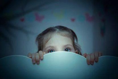 little girl is afraid of shadow of tree