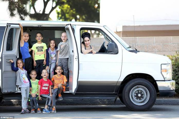 3816743a00000578-3781725-just_enough_room_the_kids_need_a_van_to_ferry_them_all_around_th-a-5_1473705243532