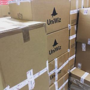 Pile of UniWiz boxes storing students belongings