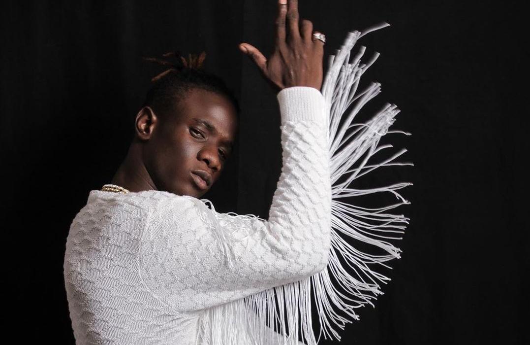 "Gambian Superstar Jizzle Outdoors Feel-Good ""Work & Pray"" Visuals"