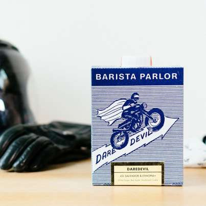Barista Parlor Daredevil coffee box with helmet and gloves in the background