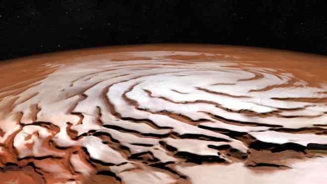 Vista en perspectiva de la capa de hielo del Polo Norte de Marte y sus distintivos canales oscuros formando un patrón en forma de espiral.