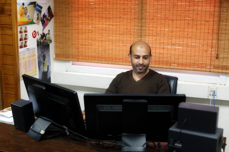 40-year-old Sami Yousef, Digital Editor at UNRWA TV and Multimedia Unit, part of the Gaza Field Communications Office, at his editing desk. © 2017 UNRWA Photo by Khaled Tiama