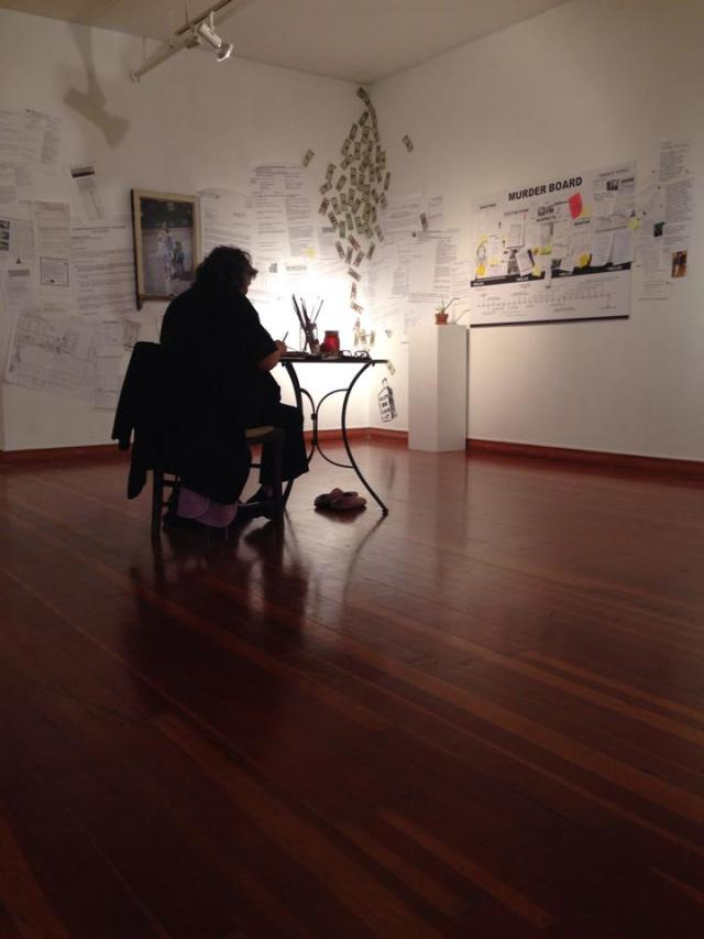 "Y. Lopez working on ""Home/Studio: Eviction Scene Investigation"" (MCCLA, 2014)"