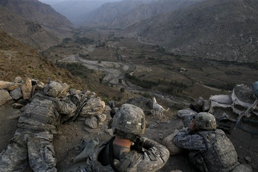 U.S. soldiers from the 2nd Battalion, 12th Infantry Regiment, 4th Brigade Combat Team, 4th Infantry Division take an overwatch position on a mountain top in the Pech Valley of Afghanistan's Kunar province Saturday, Nov. 7, 2009. (AP Photo/David Guttenfelder)