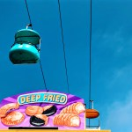 Sky glider with a sign that says: deep fried underneath at the Santa Cruz Boardwalk.