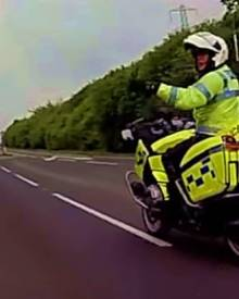 Cyclists debate law with Motorcycle Cop.