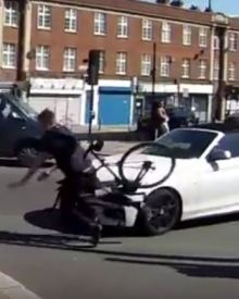 Car hits cyclist making illegal left turn into then drives away