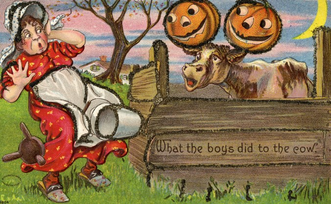 Depicts a milkmaid, startled by cow with pumpkins attached to its ears. Hallowe'en series no.980. Number 9804 appears on front, lower left