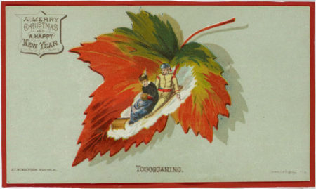 Image is of a maple leaf on which a scene of two individuals tobogganing has been superimposed