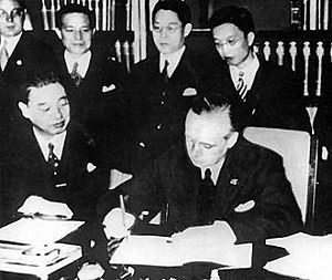 Joachim von Ribbentrop signing the Anti-Comintern Pact