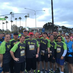 Jeff (center) with part of his team from OCRM at the start of the OC Half Marathon.