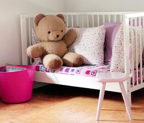 Repurposed crib - reading nook