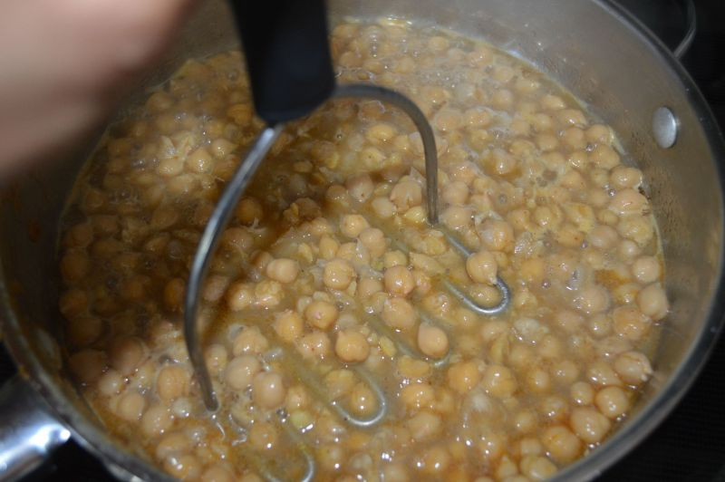 Add chickpeas and mash