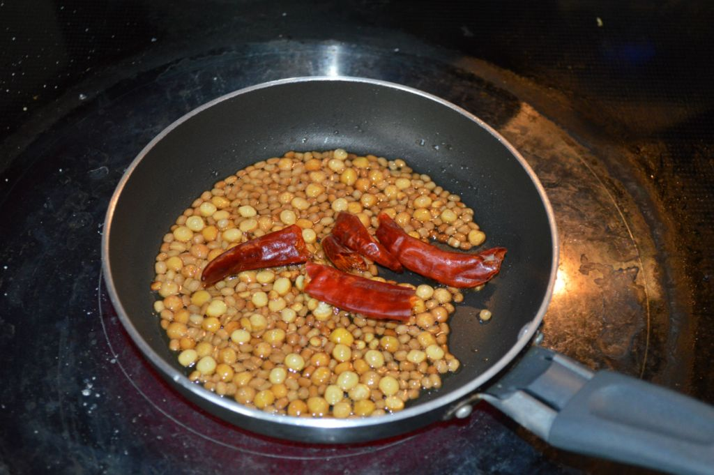 Roast and powder dals and red chilies
