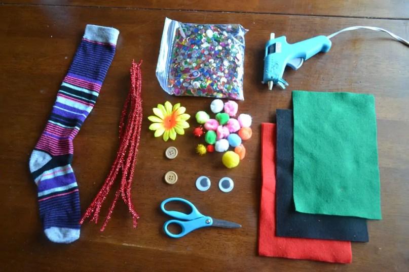 supplies, sock, scissors, hot glue gun