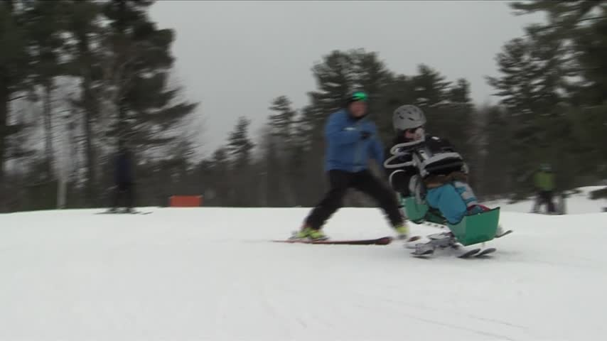 Iron Mountain group helps man with ALS ski_00515938