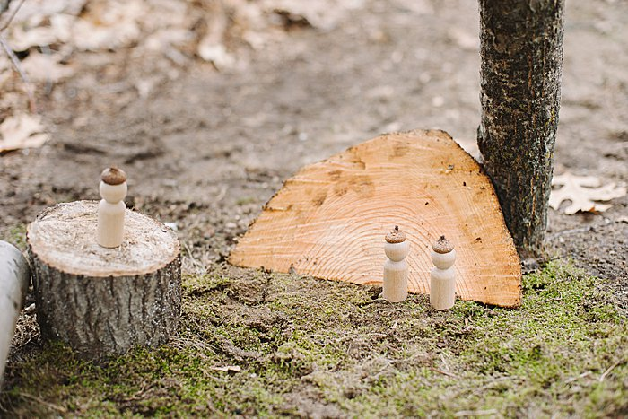 wooden peg people with acorn hats hot glued on for the nature house