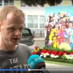 Irish fan club member being interviewed by RTE at Beatles Selfie Stand in Dublin - made by Just-Print.ie