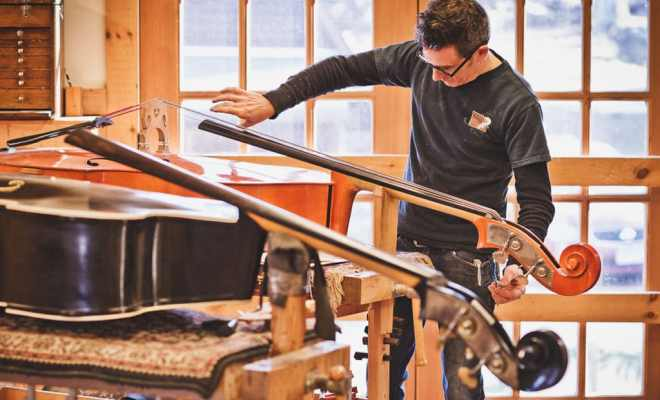 luthier working on a double bass