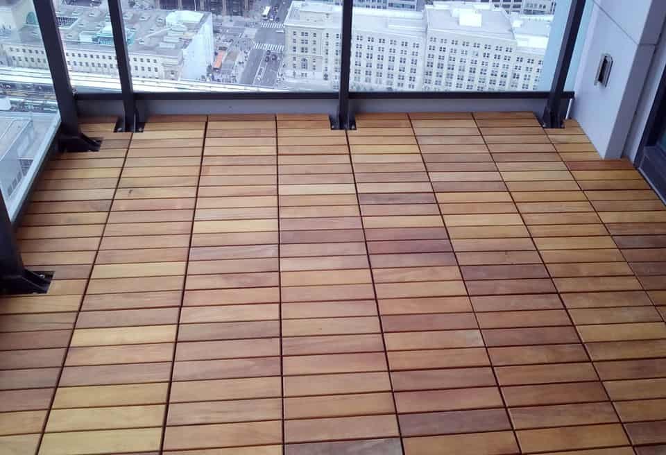 1 by 1 foot Garapa exotic wood deck tiles installed by the Royal York Downtown Toronto, Canada