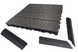 dura composite deck tile shown in charcoal grey with corner piece and ramp