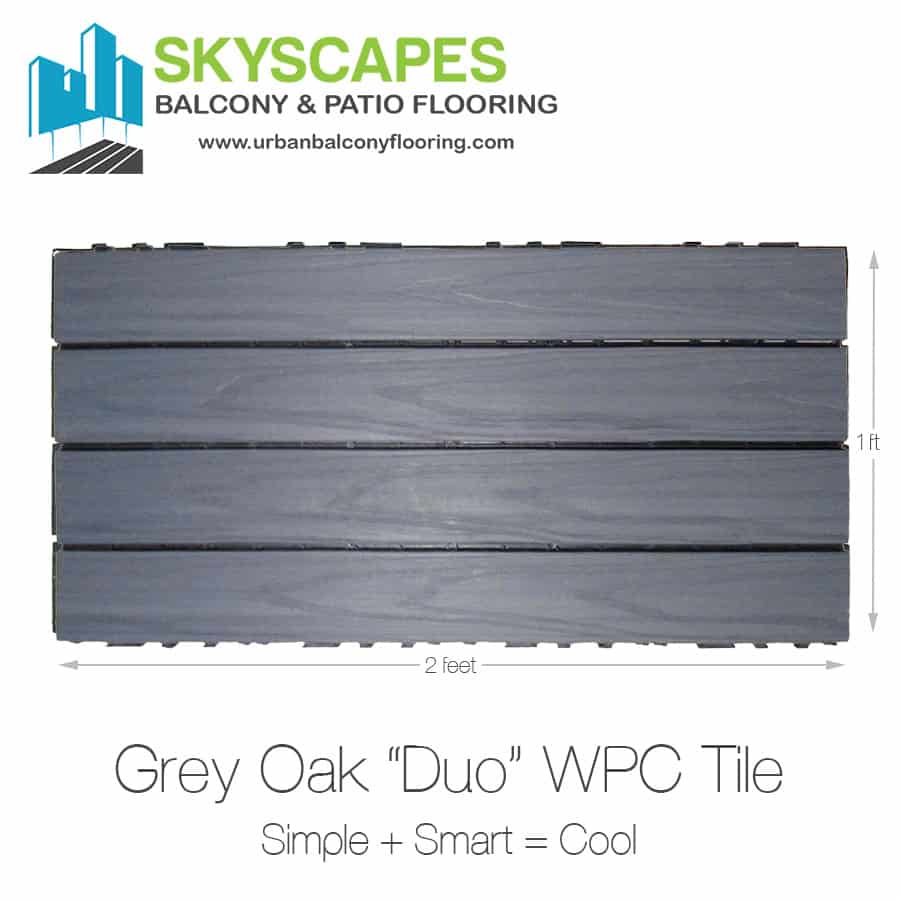 Grey Oak, 4-slat, wood-grained WPC Tile of a mid-grey colour, seen on face.  Measures 2 by 1 feet.  Skyscapes green and blue logo at top-left of image.