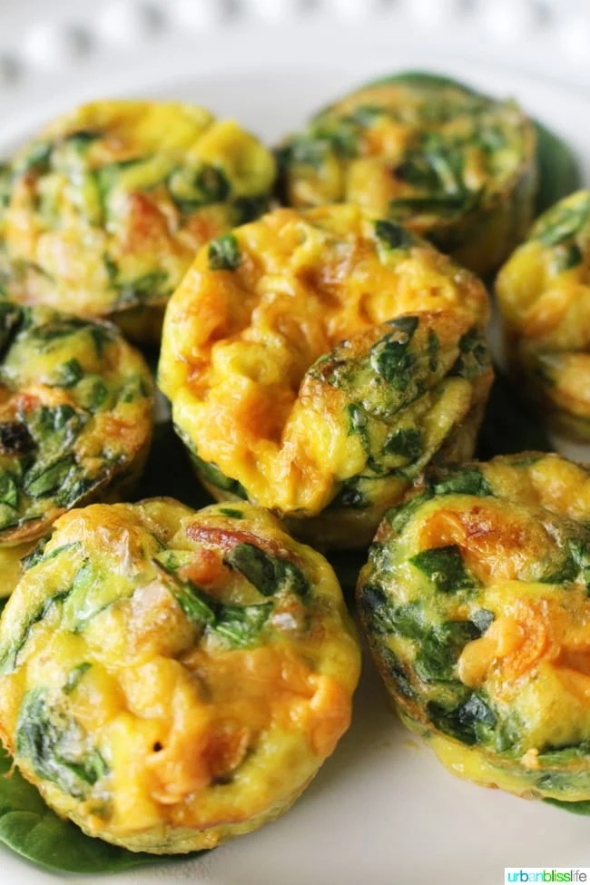 Cheesy Spinach Mini Frittatas are easy, tasty, make-ahead breakfast and brunch! Recipe on UrbanBlissLife.com