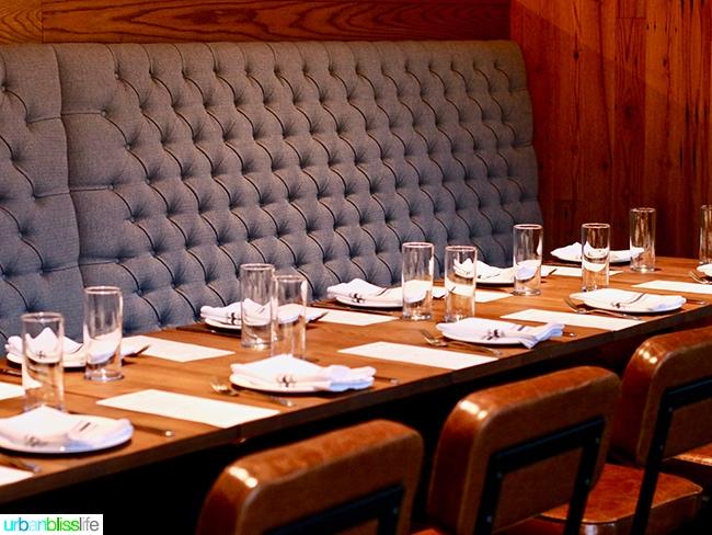 seating at Tanner Creek Tavern Portland, Oregonrestaurant review on UrbanBlissLife.com.