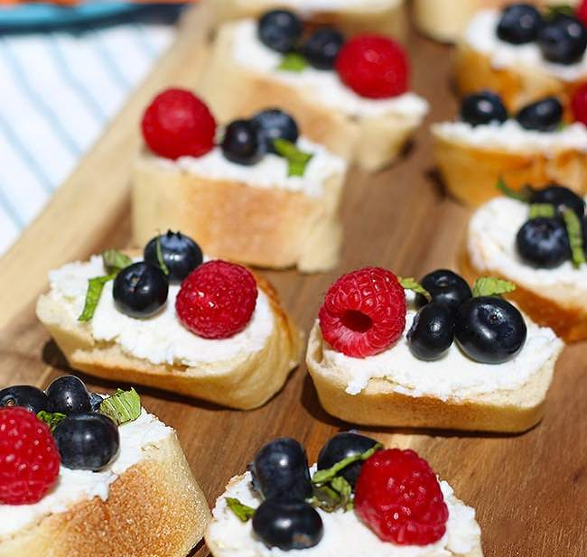 Summer Berry Crostini with Honey Ricotta and Mint