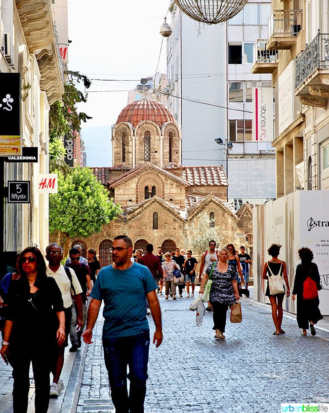 Athens street scene with Church of Panagia Kapnikarea in background