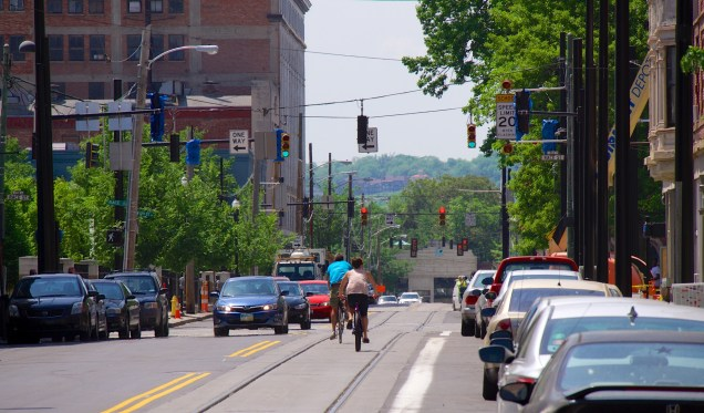 Bicyclists ride along recently completed streetcar tracks on 12th Street [Travis Estell]