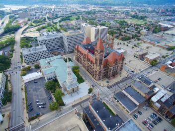 The lot to the right of City Hall is the site of competing proposals. [Photo by Travis Estell]