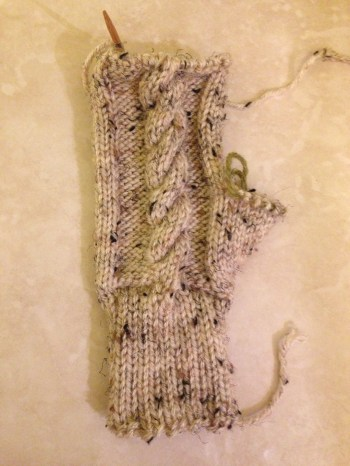 Cable knitting mittens help them fit better.