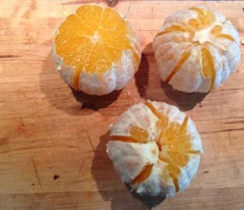 Peel oranges.