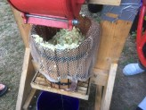 The pulp goes into the bucket to be pressed.